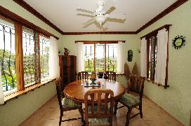 Casa Gavilan's beautiful dining room has windows viewing the pool, the lake, and the birds!
